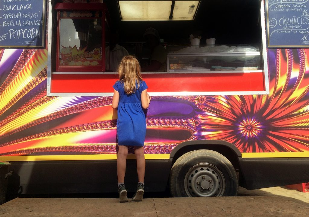 Girl in front of a food truck