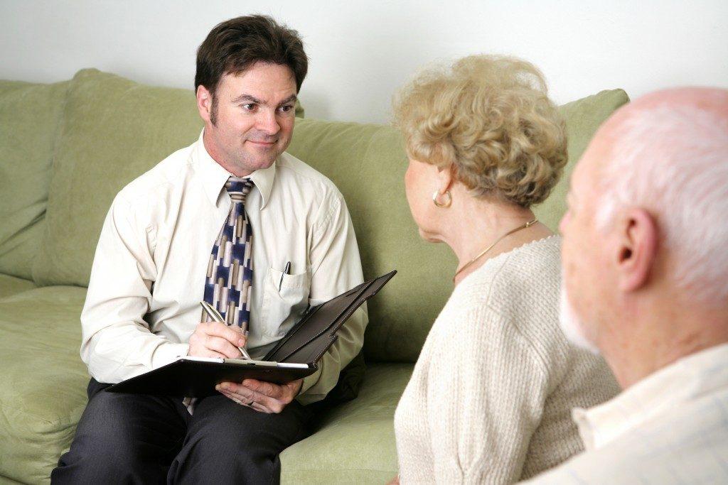 Funeral representative talking to senior citizens