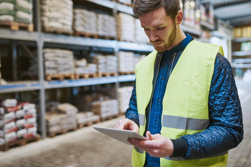 Warehouse supervisor using a tablet