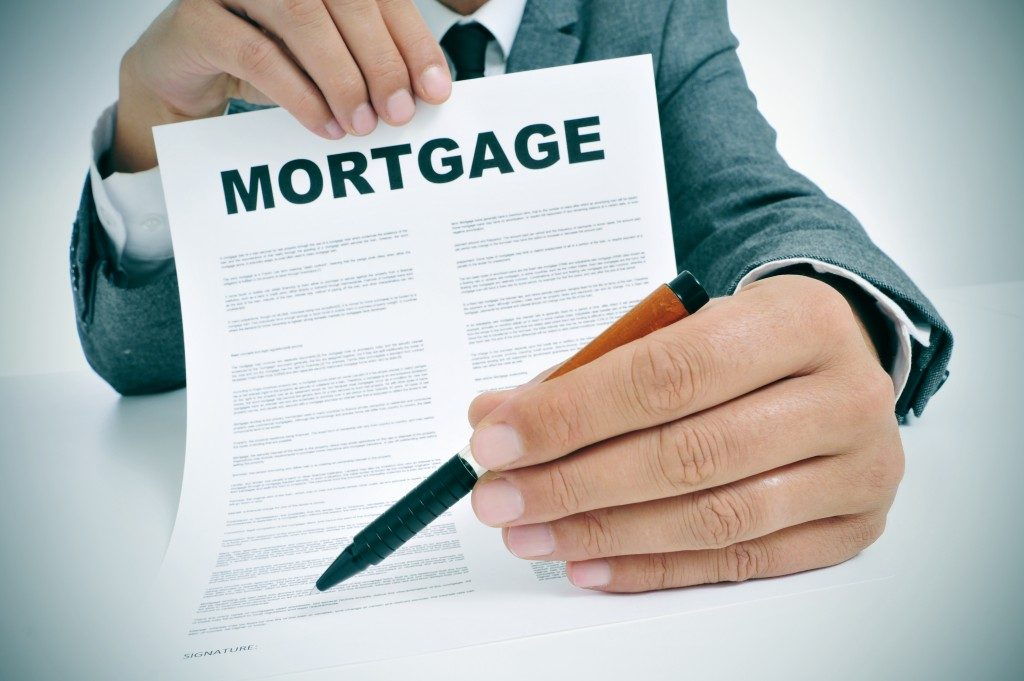 Man show mortgage document