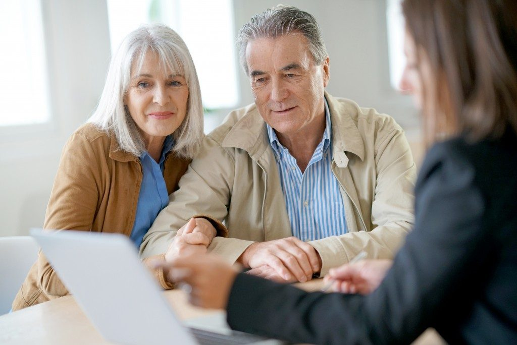 old couple talking to insurance agent