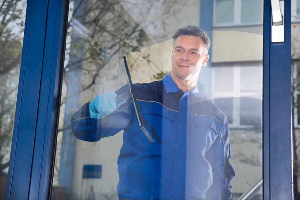 Mature professional window cleaner