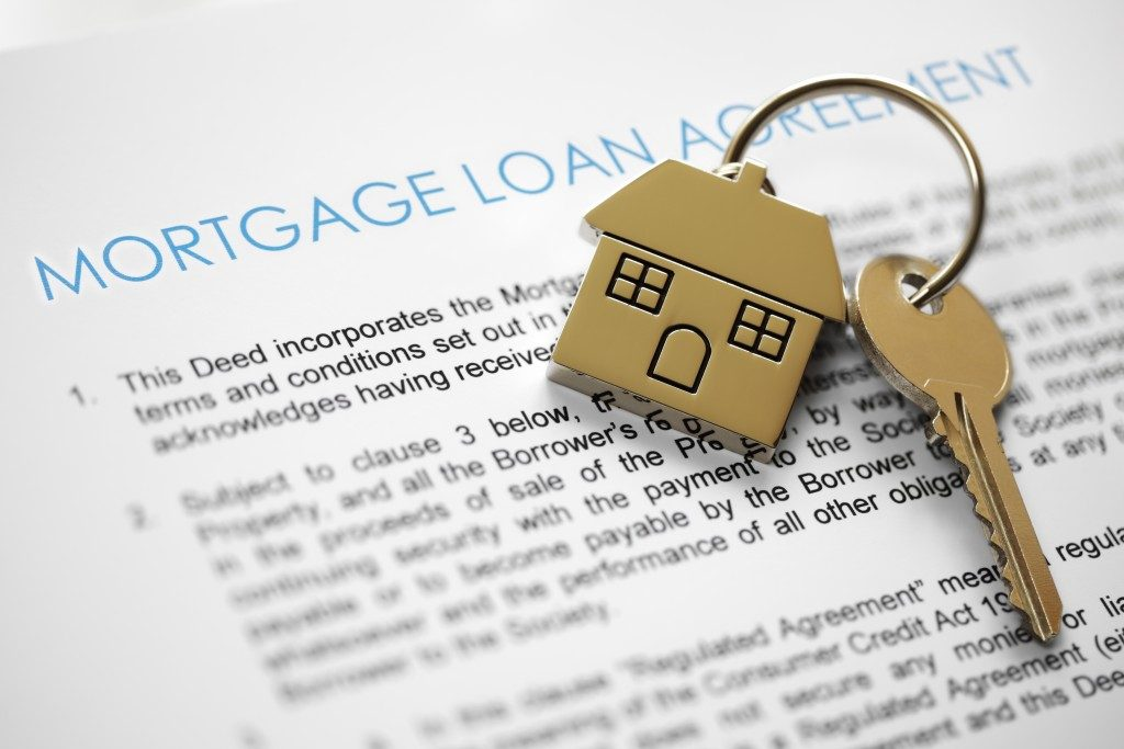 Mortgage loan application form with house keys