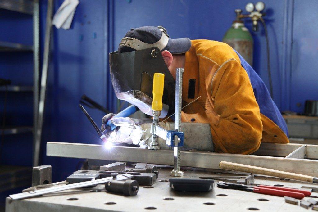 man wearing protective welding gear