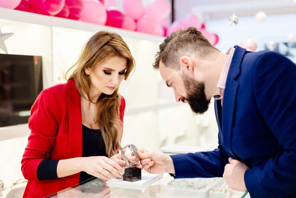sales representative assisting a client