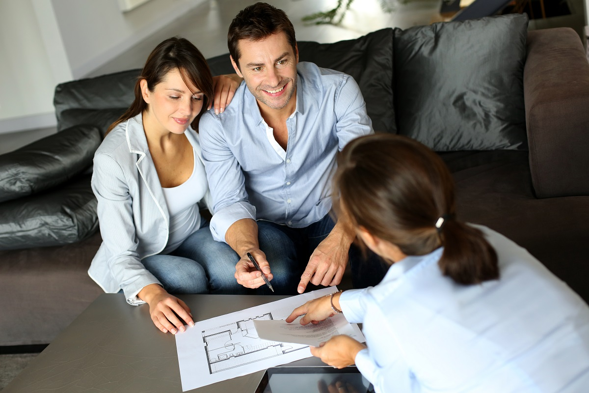 couple talking to real estate agent