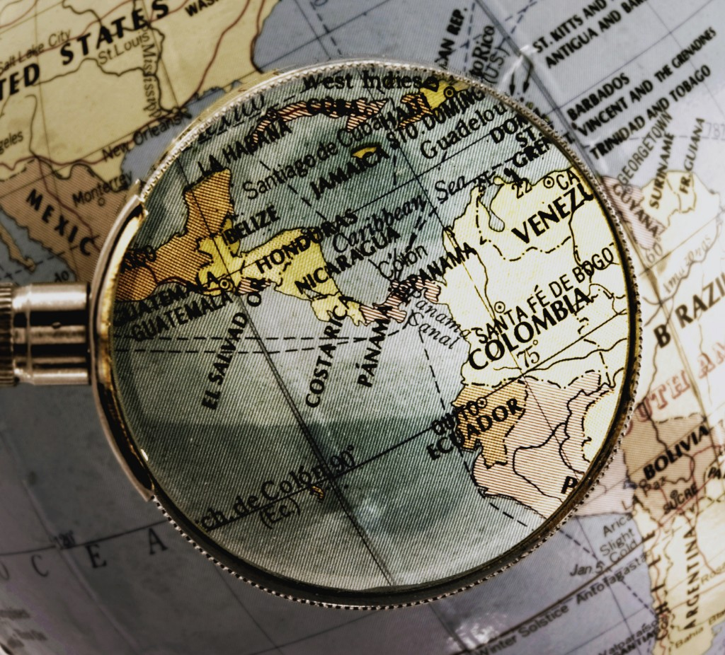 magnifying glass on globe