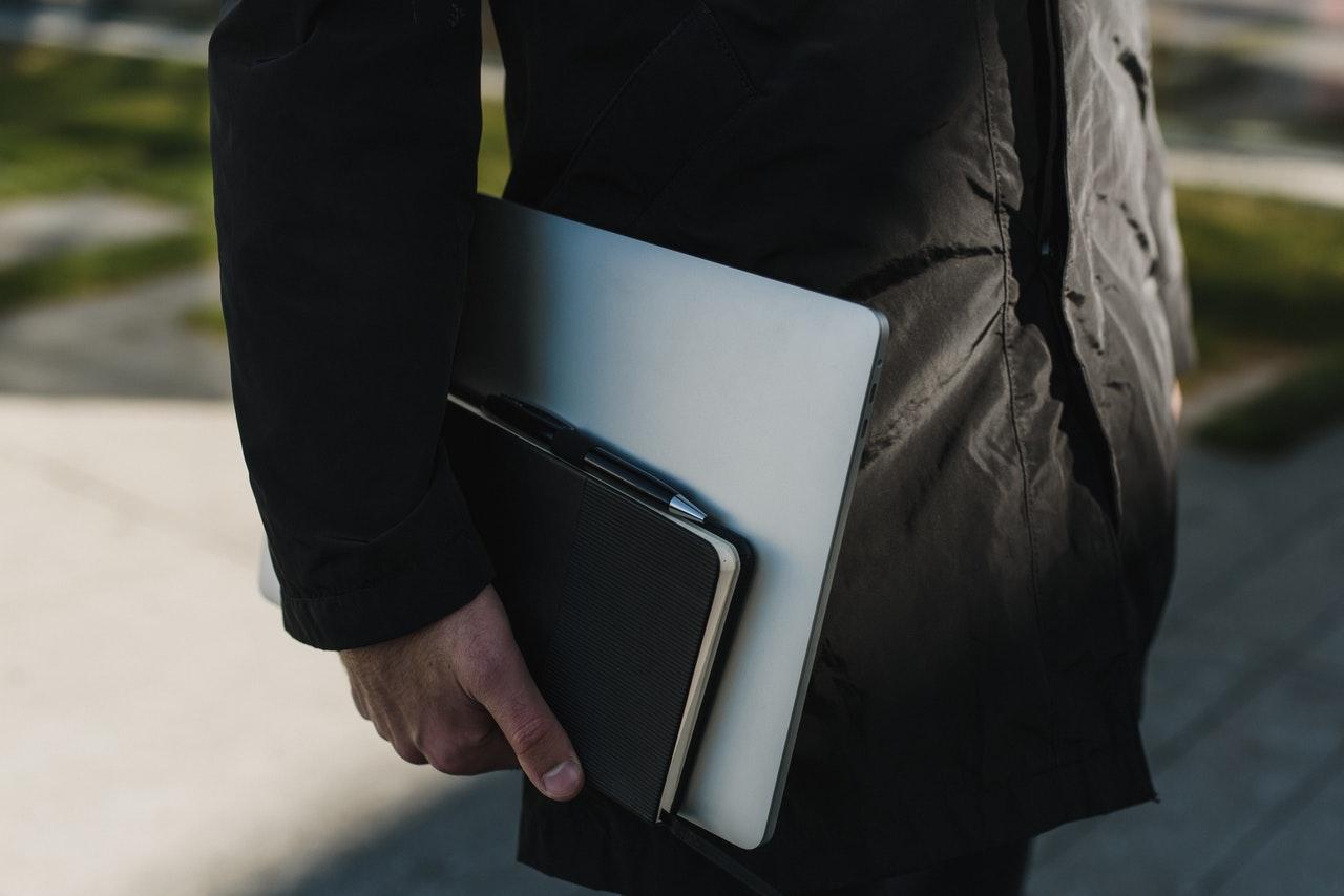 person holding his portfolio