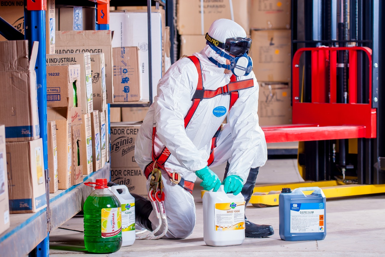 cleaning service wearing full PPE