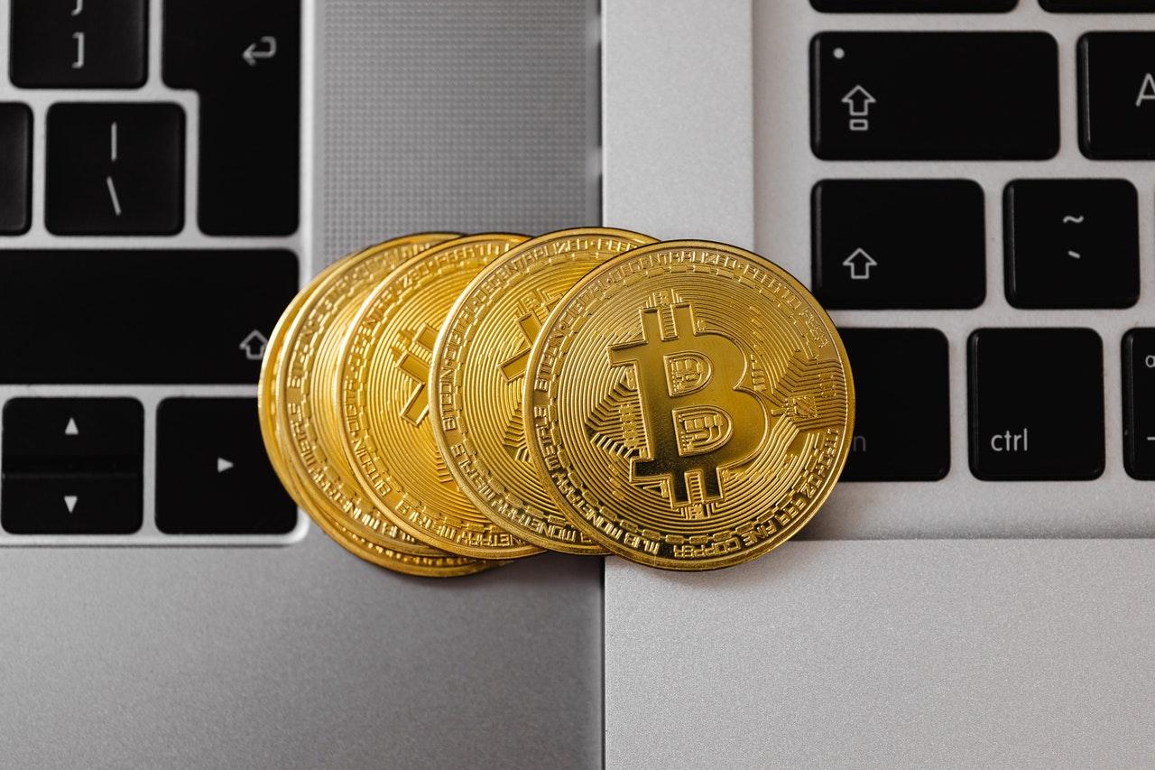 bitcoin coins on a laptop