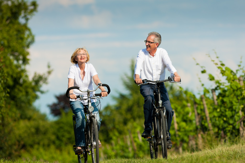 two senior couples biking